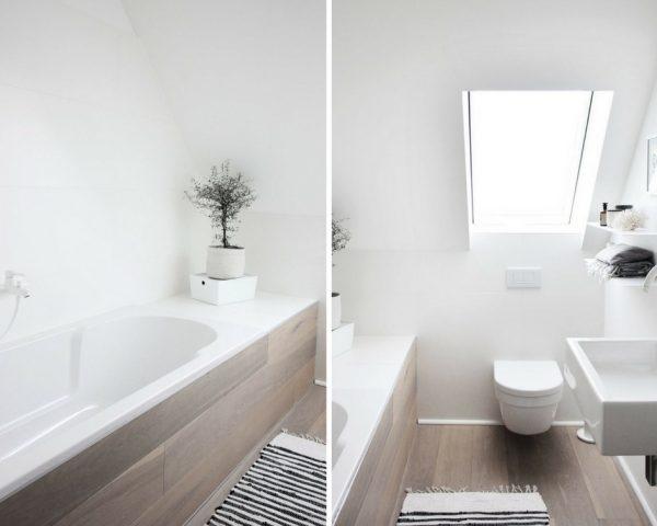 Weißes Badezimmer mit Badewanne